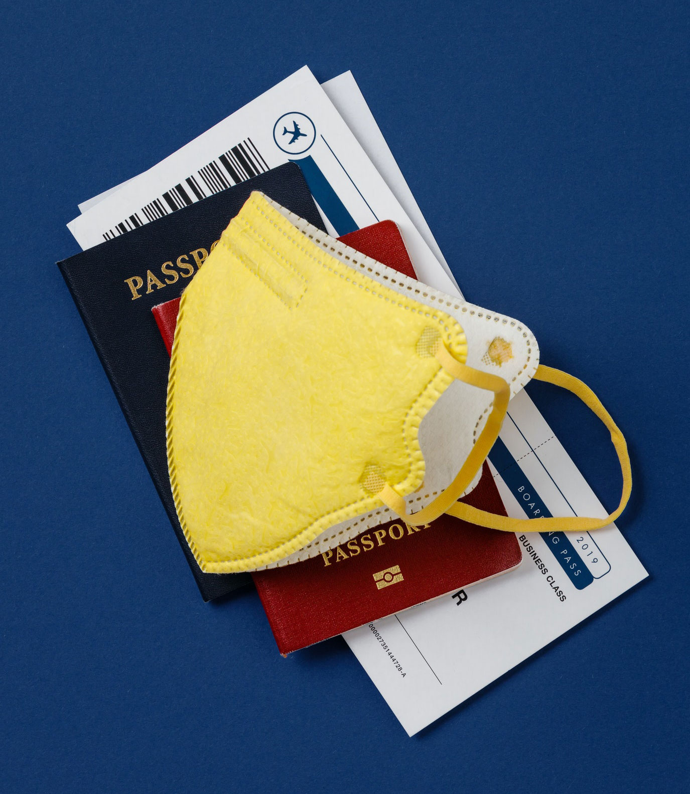 coronavirus-and-travel-concept-passports-airplane-tickets-and-medical-mask